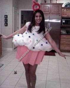 Homemade Cupcake Costume: I used a $2.00 laundry basket that I cut in half for this Homemade Cupcake Costume. I folded 3 sheets of pink poster board and glued them around the edge