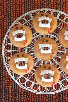 These adorable Halloween pumpkin spiced doughnuts are unbelievably simple to decorate — all you need are some plastic vampire teeth and a little gel food coloring.