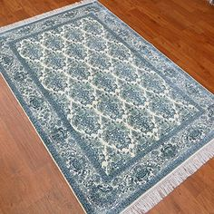 Camel Carpet Light Blue Turkish Silk Carpet Double Knotted 4'x6' http://www.amazon.com/dp/B00X52L5LI/ref=cm_sw_r_pi_dp_0Ecixb0F16D20
