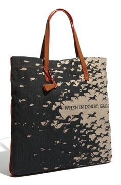 """Prepare to swoon as a flourish of horses take flight across the oversize 19 1/2″W x 19 1/2″H linen/cotton bag and audaciously declare """"When in doubt, Gallop."""""""
