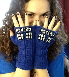 Knitting Pattern TARDIS Mitts - TARDIS Mitts  Fingerless mitts for Doctor Who fans. Pictured project by ianda67 includes the modifications of a black background to the words and black frames on the windows.
