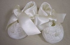 Fancy, ivory silk baby shoes - perfect for baby's Christening and so much more.