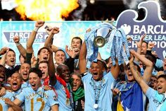 Manchester City players celebrate as Captain Vincent Kompany lifts the Premier League trophy. Manchester City, Manchester United, Football Troll, World Football, Vincent Kompany, Kun Aguero, Premier League Champions, Association Football, Soccer Skills