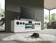 Dieses geschmackvolle TV-Element mit Soundsystem 6.1 von XORA überzeugt durch modernes Design in hochglänzendem Weiß. Optisches Highlight ist ein Einsatz aus Klarglas mit integrierter LED-Beleuchtung. Ganz nach Stimmung oder Anlass lässt sich das farblich passende Ambiente einstellen. Dank einem zusätzlichen Einlegeboden passen Sie den Stauraum individuell an Ihre Bedürfnisse an. Genießen Sie entspannte Musik- und Fernsehabende mit diesem ansprechenden TV-Element!