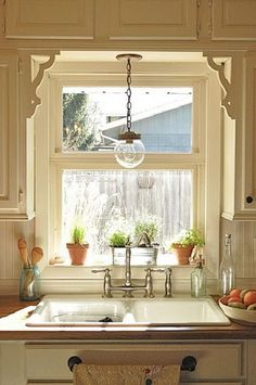 I love how the window is framed with cabinets! Why didn't I do this with mine????