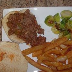Homemade Sloppy Joes Allrecipes.com  I used just 1/2 cup of water, total, and organic tomato puree instead of ketchup. No rolls, top baked potato.