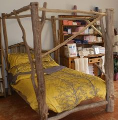 4 poster tree theme bed | four-poster bed made from tree branches