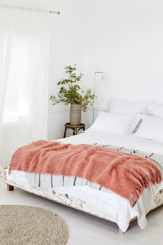 The coral coloured Tudela blanket sings out amongst the white scheme