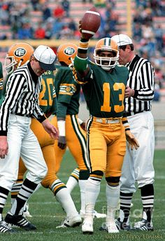 Photograph of Edmonton Eskimos cornerback Larry Highbaugh holding up the ball signaling a turnover on this play against the Ottawa Rough Riders, 1981.
