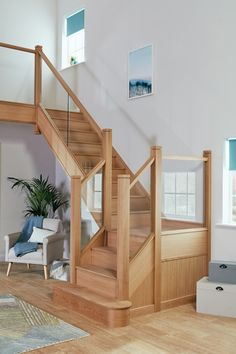 Neville Johnson glass and oak staircase renovation. This striking transformation combines a contemporary clear glass balustrade with a solid oak handrail for a timeless look. Staircase Storage, House Staircase, Staircase Makeover, Staircase Railings, Staircases, Staircase Ideas, Stair Storage, Hallway Ideas, Oak Stairs