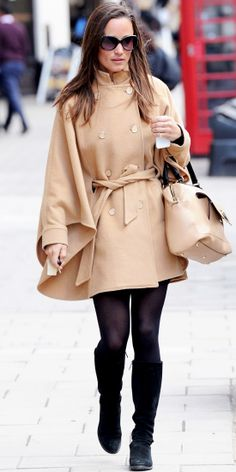 While out in London, Pippa Middleton showed her street style in a camel cape, complementary tote, black shades and knee-high boots.