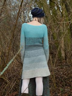 I love the color and length of this sweater! I would wear a ruffled skirt with it instead of wearing it as a dress.