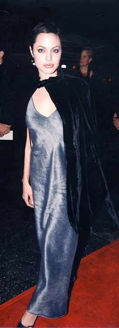 No one can forget Angelina Jolie's goth-inspired looks from the '90s. Of course, she usually brought them lots of edge, showing off her hip bones in low-waisted jeans or, in this case, throwing on a dramatic velvet cape.