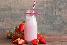 strawberry smoothie or milkshake in a bottle with straw