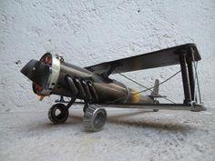 Werejo Trims Biplane Scrap Metal Sculpture