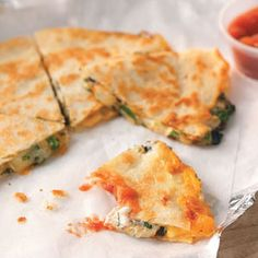 Three-Cheese Quesadillas Quick Dinner Recipe from Taste of Home -- Our taste-testing panel swore this dish was from a restaurant. -- Submitted by Sandy Smith of Saugerties, New York
