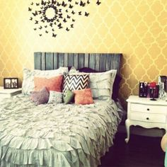 Pretty, pretty.  I love the wood headboard.