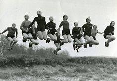 photograph of 12 German ladies jumping, circa 1955