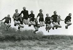photograph of 12 German ladies jumping, circa 1955
