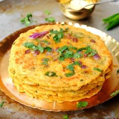 Spicy Indian flat bread made with chickpea flour topped with cilantro and onions. Makes for a great healthy snack and goes with any curry. (Missi Roti)