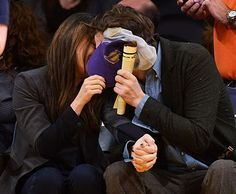 Mila Kunis and Ashton Kutcher share a smooch for the Kiss Cam at Lakers game on Friday, Jan. 3, 2014