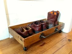 Boot Box on Wheels Old Pipe Handle - Storage Box -  Rustic boot Box - Vintage - Reclaimed Wood - Shoe storage - Mudroom - Wood - Wooden Box by TexasFrenchMarket on Etsy https://www.etsy.com/listing/224713025/boot-box-on-wheels-old-pipe-handle