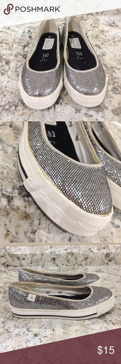 🌴NEW LISTING🌴 Converse One Star Sneakers Silver.  Appear to be glitter. Shows signs of wear. Brim of the shoe is soiled. Glue is turning brown where shoe meets the sole. Shoe has been stored for a couple of years. Has a slight smell. Size one. (9/23) Converse Shoes Sneakers