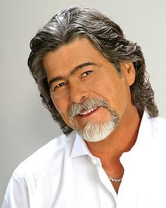 Randy Owen of the group Alabama.  i can't find a decent earlier pic of him.  but trust me. .adorable. . and the same eye shape that is becoming a vaguely disturbing trend on this pin board.