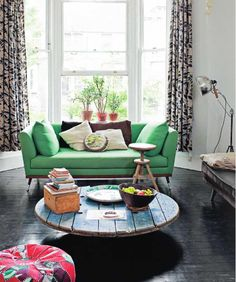 Green sofa, lots of light