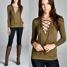 1 HR SALELILITH lace tie up top - OLIVE Fitted, long sleeve top. Lace up at front with spaghetti tie. This top is made with heavy weight, knit jersey fabric that is soft, stretches very well and is not sheer. Fabric 95% Rayon, 5% Spandex Made in U.S.A. AVAILABLE IN OLIVE & BLACK. Tops Tees - Long Sleeve