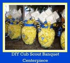 How to make a blue and gold Cub Scout banquet centerpiece using inexpensive items and white chocolate molds. Inexpensive Centerpieces, Banquet Centerpieces, Gold Party Decorations, Balloon Centerpieces, Tiger Scouts, Cub Scouts, Cub Scout Blue And Gold Centerpieces, Cub Scout Popcorn, Cub Scout Activities