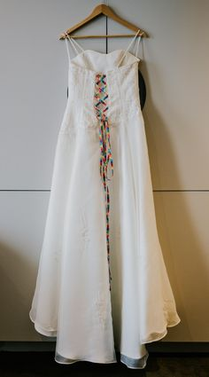 Photograph of a long white sleeveless wedding dress tied at the back with rainbow coloured lace Photography Ideas, Wedding Photography, Yes To The Dress, White Wedding Dresses, Tie Dress, Rainbow Colors, Weddingideas, Manchester, Centre