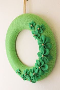 This super-chic wreath is made with two of the most inexpensive craft supplies out there: yarn and felt. Get the tutorial from Make Bake Celebrate » What you'll need: foam wreath ($6, amazon.com), green yarn ($4, amazon.com), green felt ($3, amazon.com)