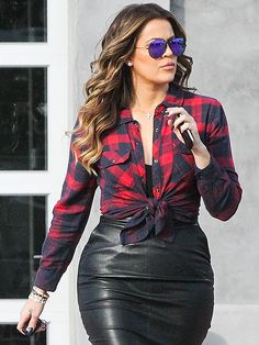 Khloé Kardashian goes mad for plaid while filming Keeping Up with the Kardashians in Chatsworth, California, on Monday.