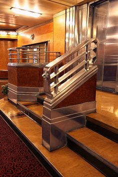 Art Deco Elevator Landing, RMS Queen Mary    		This seemed like a posh way to dress up a set of stairs leading to the  elevator.  The art deco styling is very strong here.
