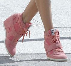 Alessandra Ambrosio in Ash Bowie pink wedge sneakers at a photo shoot in Santa Monica, March 8, 2013