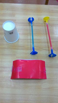 Color cups, attach cup to paper. Loop paper around straws, loosley. Kids can blow car across flat surfaces. Straws will turn wheels.