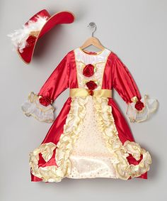 Little princesses will feel like the belle of the ball in this satiny gown and matching hat. The zipper in back makes slipping it on as magically simple as getting touched by a fairy godmother's wand.  Includes dress and hatPolyesterMachine washImported
