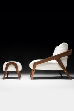 A Canaletto walnut solid wooden sinuous structure finished in a water based paint together with upholstery to the highest standards in contrast in the finest natural linen. Enhancing the contemporary feel. The Italian Designer Contemporary Walnut Arm Chair and Footstool is the ultimate in modern style, unique in its simplicity. Available as a set or separately. A set that would suit any interior, adding the upmost in style.