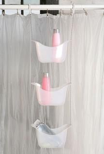 11 essential bathroom organizers that get the job done.: Hang a shower caddy for extra storage.