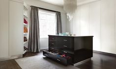 Beautiful white and black gloss walk in wardrobe in a Chelsea residence love the curtains