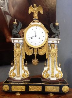 Typical #Empire style #portico #clock in #ormolu and #marble. 19th century. For sale on Proantic by Leonide Gianluca.
