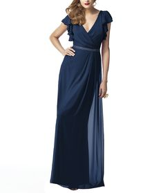 Dessy Collection 2874 is a full length, V-neck bridesmaid dress with ruffle cap sleeve and matching belt at natural waist. Style 2874 is made of lux chiffon.