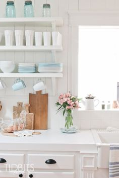 Bright white cabinets, open shelving, and pale blue accents all help make this spring kitchen makeover truly something special. If you're looking for design ideas for your space, make sure to check out this fresh and airy layout. Retro Home Decor, Diy Home Decor, Room Decor, Kitchen Decor, Kitchen Design, Kitchen Ideas, Spring Home Decor, Bright, Beautiful Kitchens