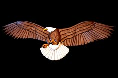 My first attempt at an intarsia project was this 90 piece intarsia eagle with a 24 inch wing-span. Intarsia Woodworking, Woodworking Patterns, Diy Woodworking, Sculpture Art, Sculptures, Intarsia Wood Patterns, Scroll Saw Patterns, Wood Creations, Pattern Art