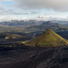 Maelifell, Iceland - :Mount Maelifell, translated as 'Measure Hill' is iconic in Iceland as it sits alone in the black desert landscape – a green moss-covered cone beacon. At 800m tall, this volcano is only reachable by four-wheel drive.