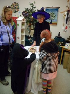 Kids' craft and activities table at MEOW-loween at Harmony Moon