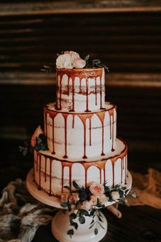 Nearly naked cake with caramel drizzle and floral details | Image by Melissa Marshall Photography
