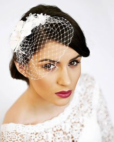 White silk flower headdress and bird cage veil by Florentès