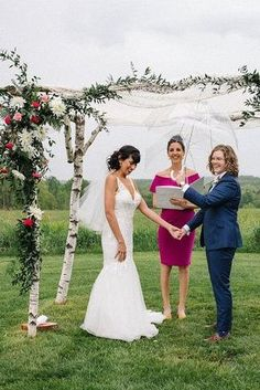 Romantic lesbian picture at their outdoor wedding ceremony under a rustic branch and lace arch decorated with greenery and flowers  | Rustic Jewish Wedding with Rainbow Details - Love Inc. Mag - BRINDAMOUR PHOTOGRAPHY Three Tier Cake, Clear Umbrella, Romantic Wedding Photos, Hanging Chandelier, Vintage Windows, Lesbian Wedding, Tiered Cakes, Greenery, Wedding Ceremony